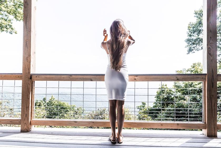blogger in little white dress
