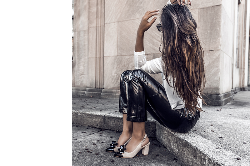 fashion blogger wearing vinyl pants and shoes