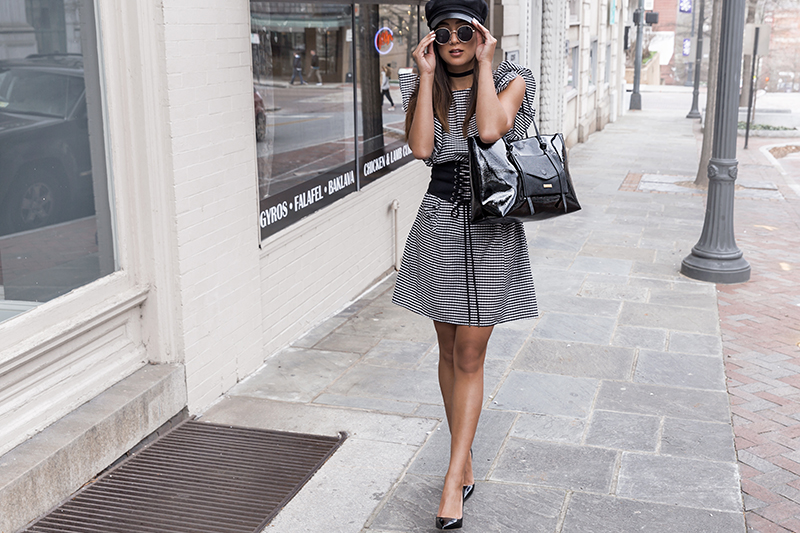 fashion blogger wears gingham dress