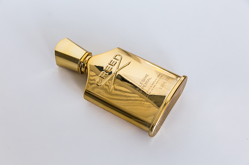 gold cologne bottle by creed millesime imperial