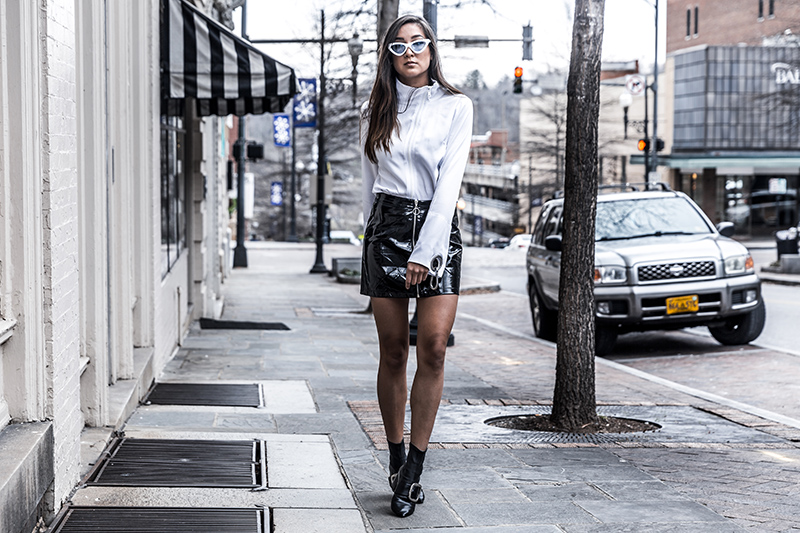 fashion blogger Kristina of day in my dreams wears a black vinyl mini skirt