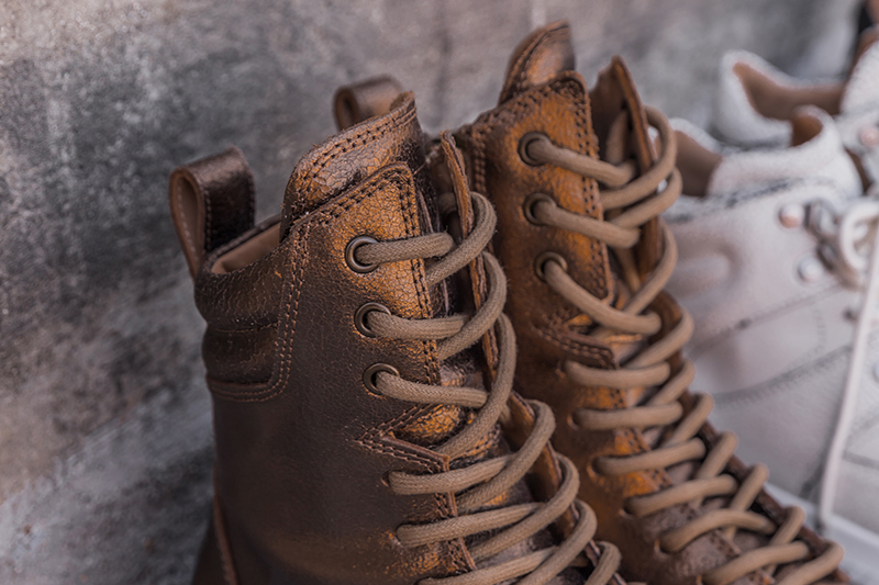 closeup of mobs tread boot in bronze laces