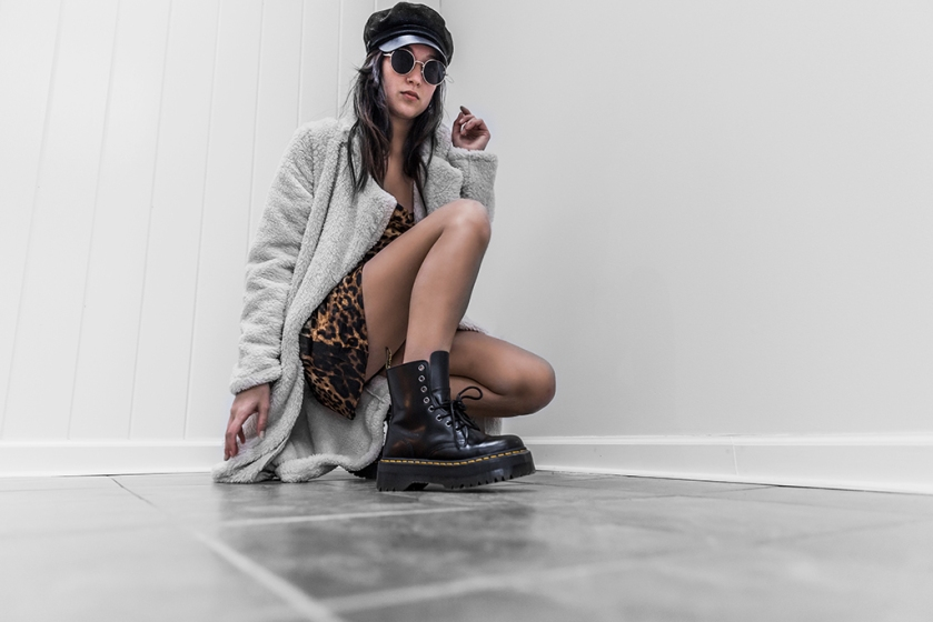 dr. marten combat boot outfit ideas with teddy bear coat, leopard dress and bus boy cap