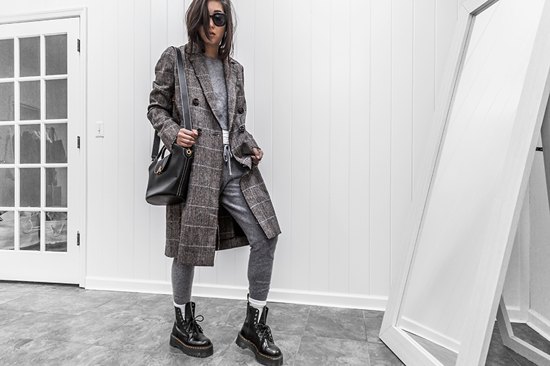 minimalist luxury fashion blogger wears dr. martin boots and plaid jacket