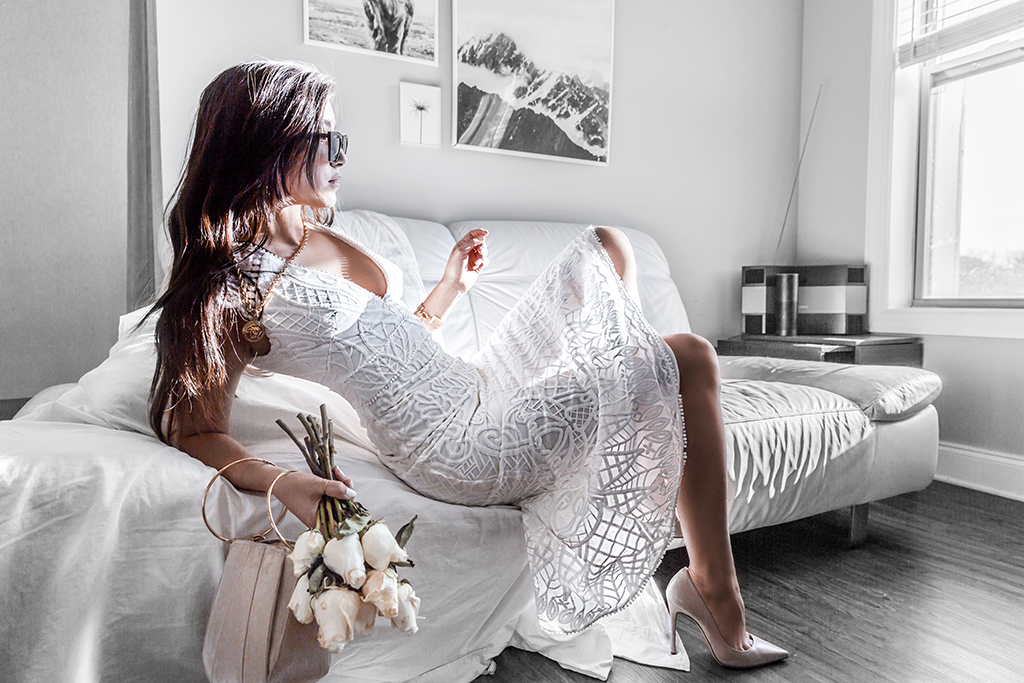 white lace dress in romantic setting