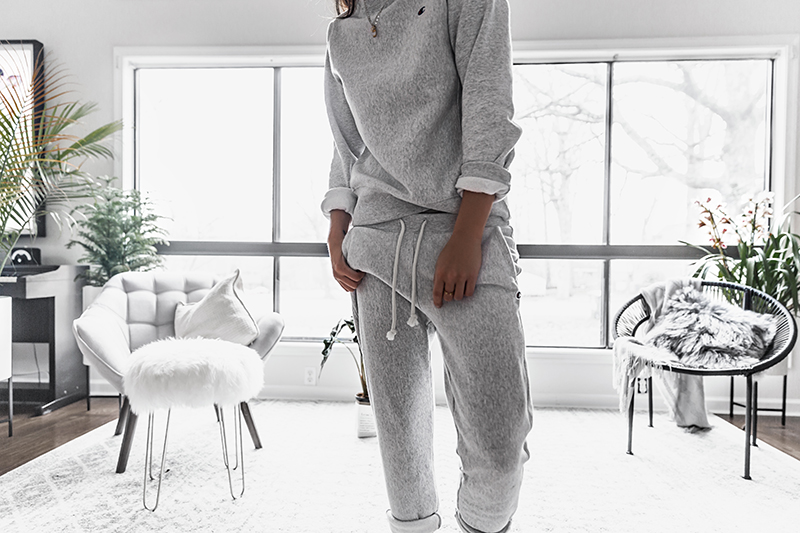 champion sweatpants and sweatshirt outfit in all white interior