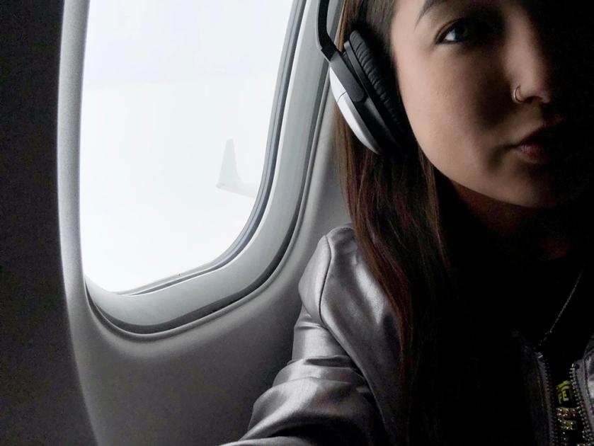 travel blogger flies first class in fendi