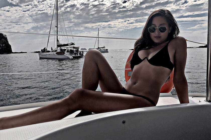 travel blogger in a bikini on a boat