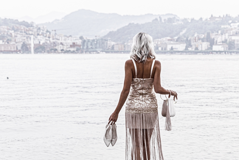luxury fashion blogger overlooking lake lugano switzerland