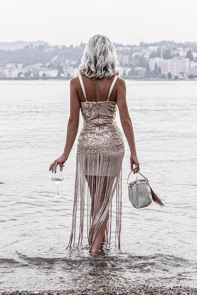 live your dreams as a luxury fashion blogger staring over lake lugano