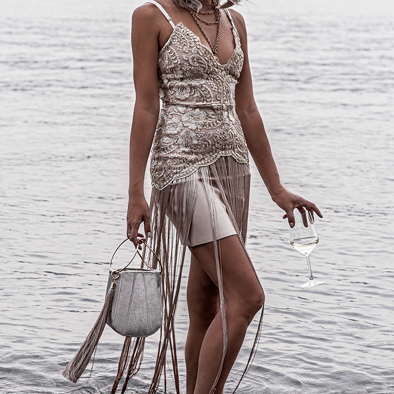 luxury lifestyle drinking prosecco by the lake lugano