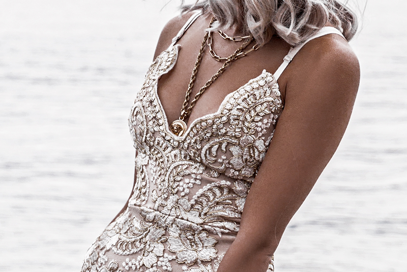 lace dress and versace medusa gold coin necklace