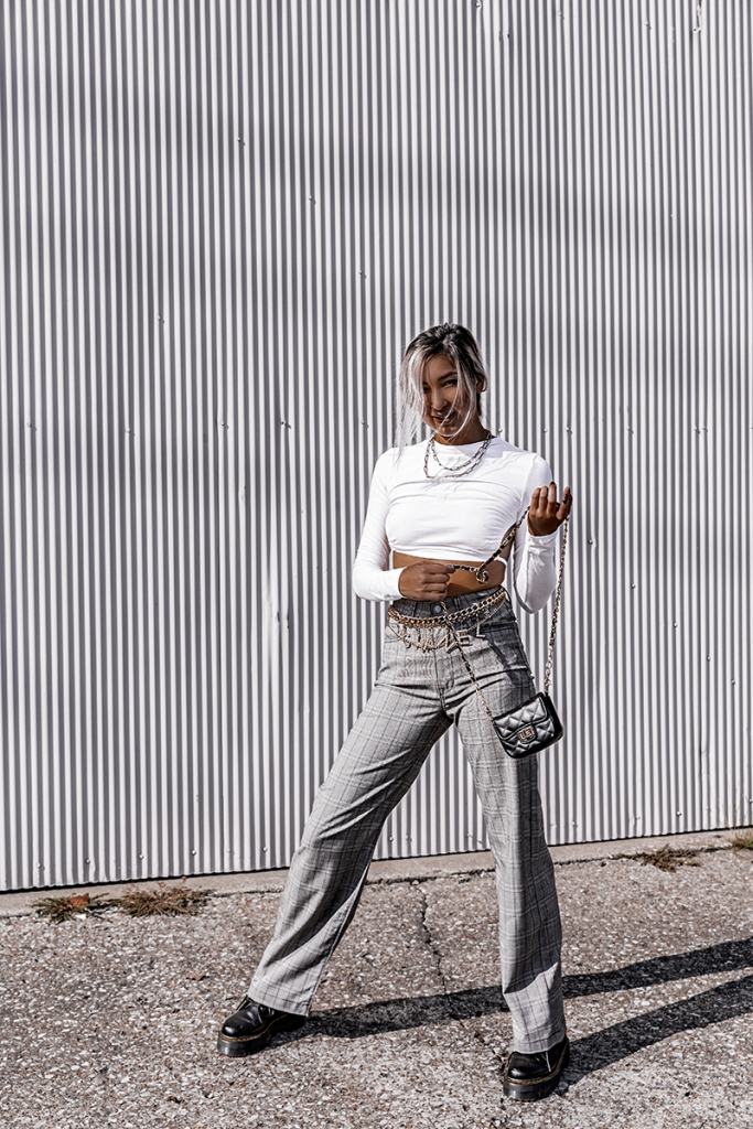 fashion blogger wearing plaid pants by fidelity denim and dr martins