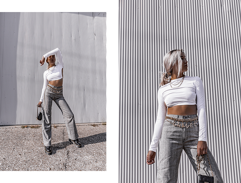 fashion blogger rocking plaid pants in the sun