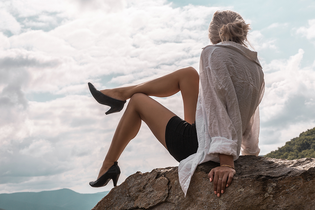 fashion blogger wears black biker shorts outfit