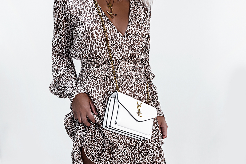 leopard print dress and luxury handbag ysl
