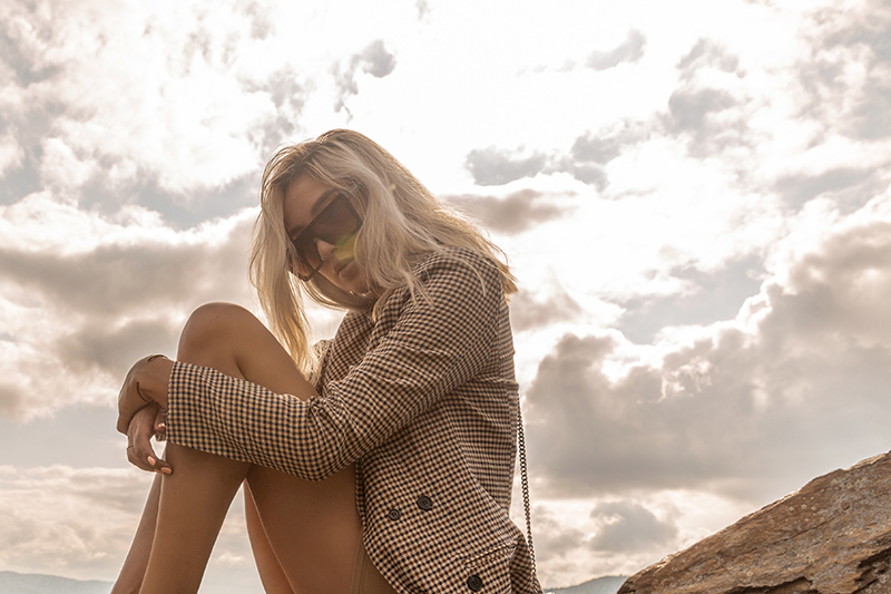 checker blazer luxury travel style at sunset