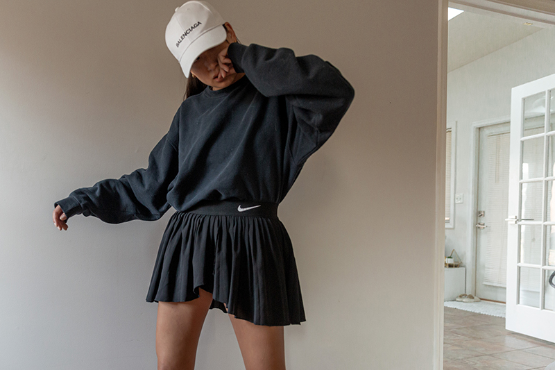 nike pleated skirt outfit with oversized sweatshirt